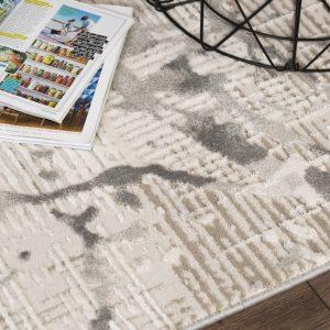 Bolero szürkés árnyalatú 3 D hatású szőnyeg részlete.